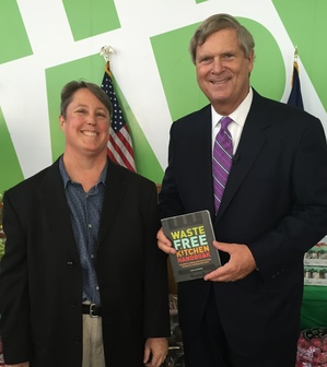 Vilsack with book 2.jpg