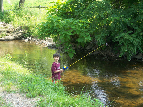photo of my son, fishing the West Branch of Perkiomen Creek