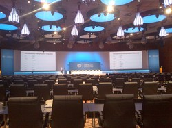 Empty Plenary Hall Doha.jpg