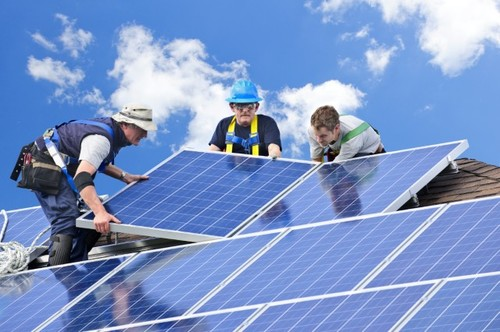 Thumbnail image for iStock_14578547_solar workers_we own_JPG.jpg
