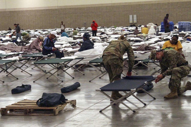 Louisiana National Guard soldiers setting up cots